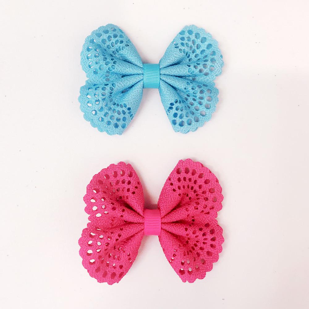 Ribbies| 典雅洞洞蝴蝶結髮夾(2入)-土耳其藍/亮桃紅